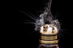 Burning of Electronic cigarette. Popular vaporizing e-cig gadge Stock Photos