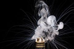 Burning of Electronic cigarette. Popular vaporizing e-cig gadge Royalty Free Stock Photos