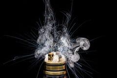 Burning of Electronic cigarette. Popular vaporizing e-cig gadge Stock Image