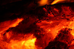 Burning embers in the dark Royalty Free Stock Photography