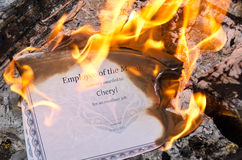 Burning Employee of the Month Certificate Royalty Free Stock Image