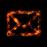 Burning envelope. Post sign from fire on black Stock Photos