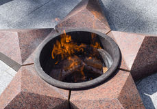 Burning of eternal fire. Five-pointed star made of granite memorial to the memory of killed soldiers Royalty Free Stock Photos