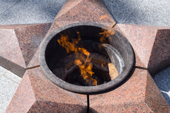 Burning of eternal fire. Five-pointed star made of granite memorial to the memory of killed soldiers Stock Photos