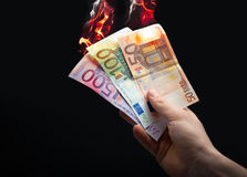 Burning euro Stock Photo