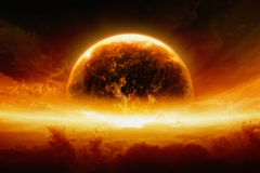 Burning and exploding planet Earth. Abstract apocalyptic background - burning and exploding planet Earth in red sky, hell, end of world. Elements of this image stock images