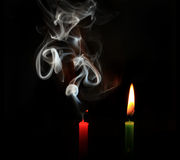 Burning and extinguished candles Stock Photography