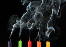 Burning and extinguished candles Stock Images