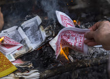 Burning fake dollars and dongs at One Pillar Pagod Royalty Free Stock Photo