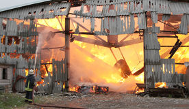 Burning farm building with hay Royalty Free Stock Image