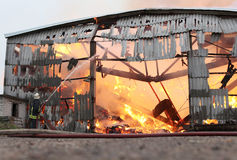 Burning farm building with hay Stock Photography