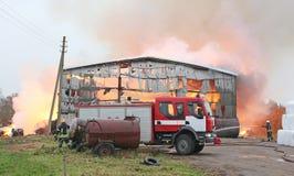 Burning farm building with hay Stock Photo