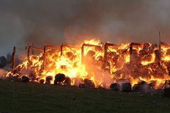 Burning farm building with hay Stock Photo