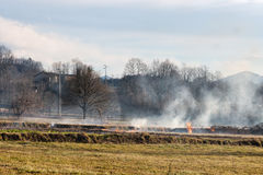 Burning fields ready for new spring season. Farming practice. Royalty Free Stock Image