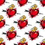 Burning fiery heart seamless pattern. Burning fiery heart pierced by the arrow of love seamless background pattern for Valentines celebrations Stock Photo