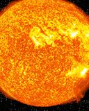 Burning and fiery sun. In outer space with some solar activity Royalty Free Stock Photography