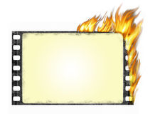 Burning film frame. Old burning film frame in grunge style Royalty Free Stock Photo