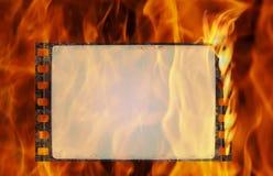 Burning film frame. Burning old film frame in grunge style Stock Images