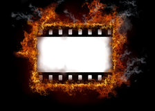 Burning film strip. Isolated on black background Royalty Free Stock Photography