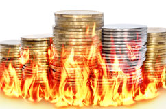 Burning financial savings isolated on white background Stock Images