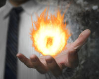 Burning fire ball in man's hand Stock Photography