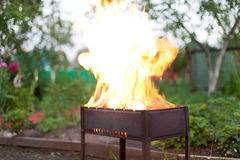 Burning fire in barbecue Stock Photos