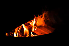 Burning fire in cast-iron oven royalty free stock photography