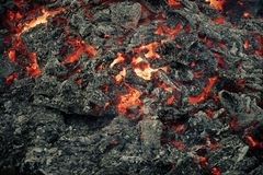 Burning fire. Danger, hazard, energy concept. Lava flame on black ash background. Formation, geology, nature, environment. Magma textured molten rock surface stock photography