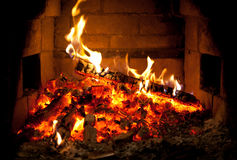 Burning fire in the fireplace Stock Photography