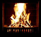 Burning fire in the fireplace Royalty Free Stock Images