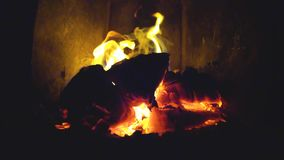 Burning fire in fireplace. Reverse slow motion firewood burns in the furnace and crack stock video footage