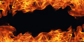 Burning fire flame frame on black. Background Royalty Free Stock Images