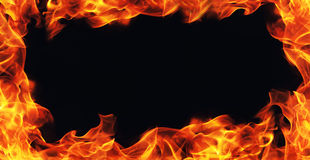 Burning fire flame frame on black Royalty Free Stock Photo