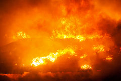 Burning fire flame on wooden house roof Stock Photo