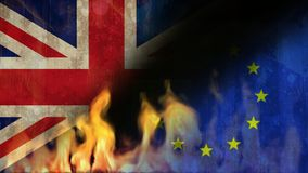 Burning flames video. Burning fire flames against animated British and Eu background stock video footage