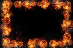 Burning Fire Flames Frame on Black. Realistic burning fire flames frame border, sparks and smoke with copy space, explosion effect on black background Stock Images