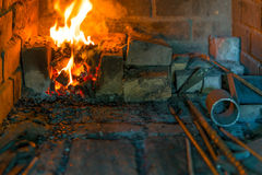 Burning fire in the furnace in  smithy Stock Photo