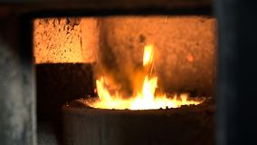 Burning fire in a pot. Using a big concrete furnace stock video footage