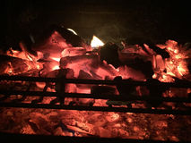 Burning fire wood and embers in the pit in the Barbecue. Stock Image