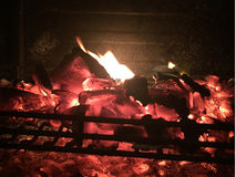 Burning fire wood and embers in the pit in the Barbecue. Royalty Free Stock Photos