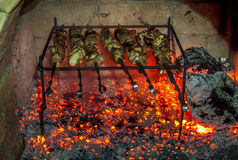 Burning fireplace and barbecue pork Royalty Free Stock Image