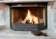 Burning fireplace and bellows Royalty Free Stock Photography