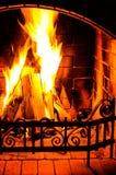 Burning Fireplace. Chimney and woodpile. Chimney place. Christma Stock Images