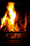 Burning Fireplace. Chimney and woodpile. Chimney place. Christmas fireplace. stock photo