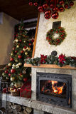 Burning Fireplace with christmas tree and decoration Royalty Free Stock Photography