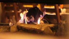 Burning in the fireplace in the comfort cozy cafe. Fireplace with just like fire. Tongues of flame in the fireplace. Fireplace with just like fire. Burning in stock video footage