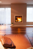 Burning fireplace in cozy interior Stock Images