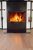 Burning fireplace in cozy room Stock Photography