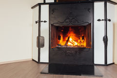 Burning fireplace in cozy room Royalty Free Stock Photos