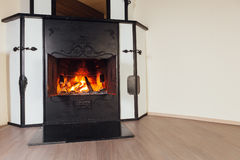 Burning fireplace in cozy room Royalty Free Stock Photography